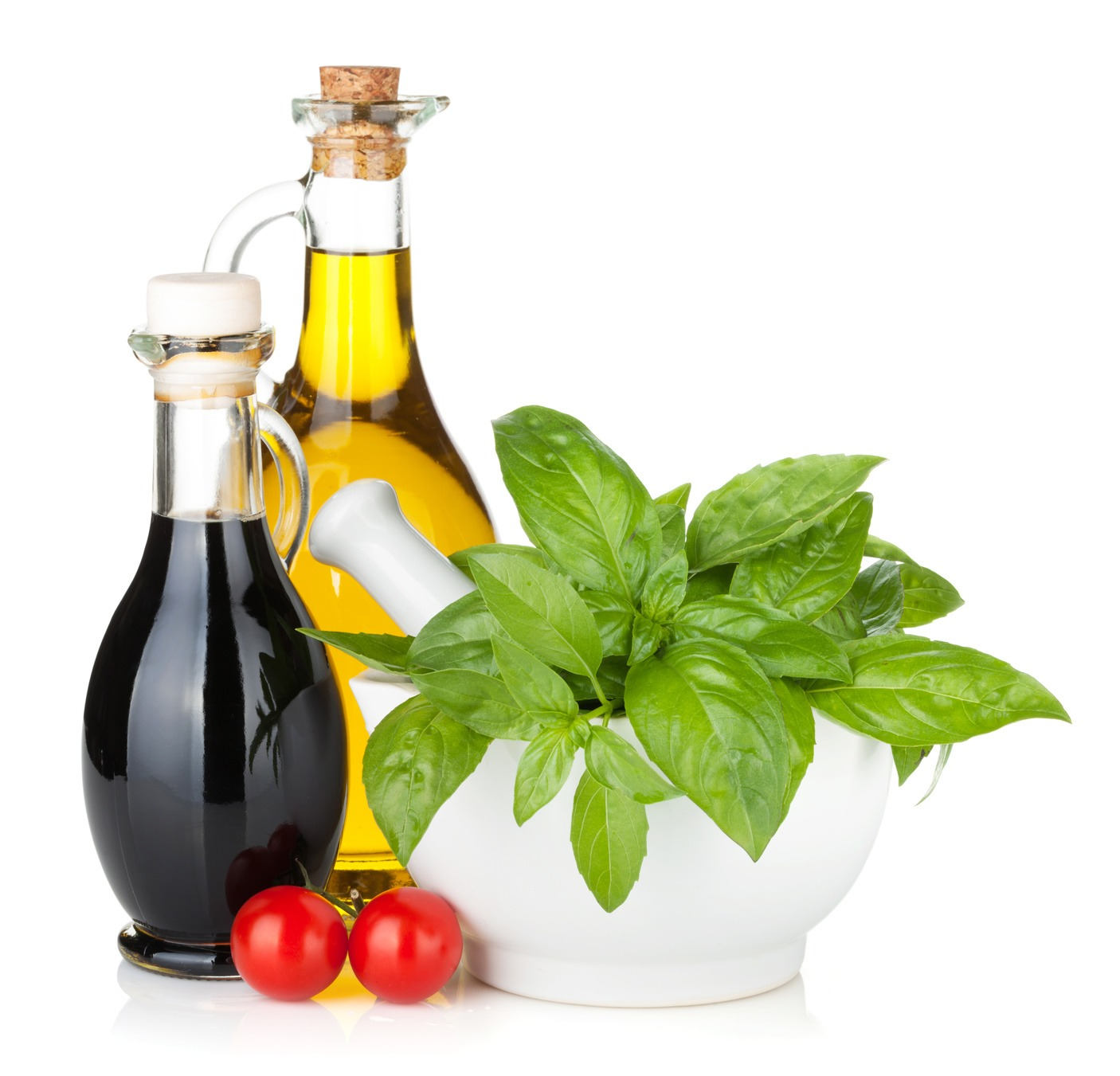 Olive oil, vinegar bottles with basil and tomatoes. Isolated on white background