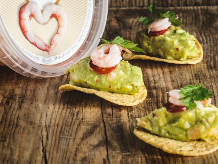Shrimp with guacamole on tortilla chips