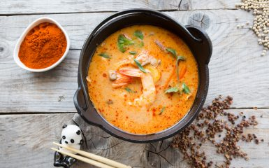 Traditional thai spicy tom yum soup in a bowl